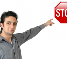 man pointing at stop sign for blog
