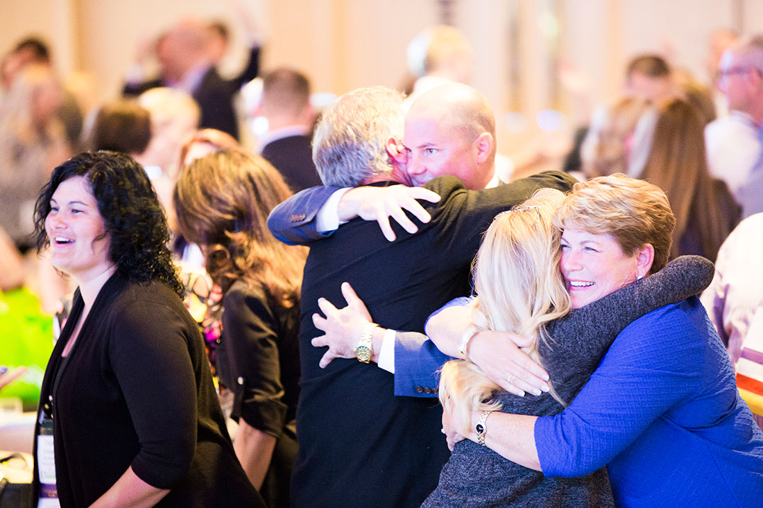 Participants hugging at the event